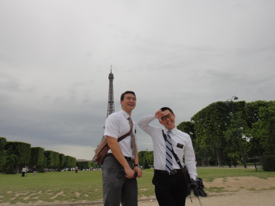 Elder Kwang (with an asian finger sign he created) and I at the Eiffel Tower